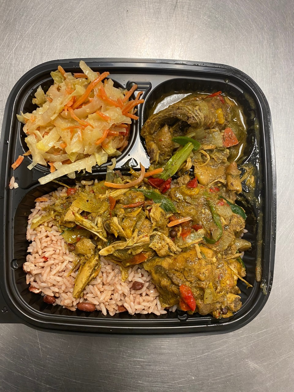 Curry Chicken A traditional Jamaican dish in which chicken is infused with the seasonings, flavours of curry powder, chopped onion, escallion, garlic, ginger, thyme and scotch bonnet. Serve With rice and Steamed Veggie  $10.00
