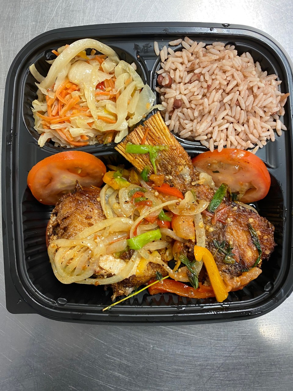 2 Fried fish Snapper . Served with rice, steamed veggie, pepper salad  $20.00