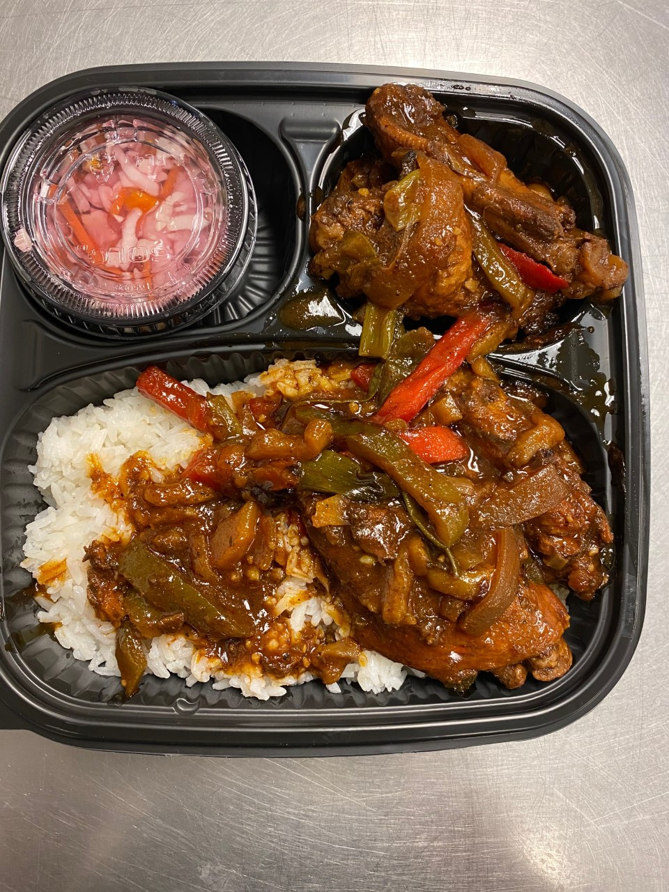 Jamaican Brown Stew Chicken A flavor Jamaican classic stewed chicken that's primarily sweet and spicy. Incredibly rich in spices and herbs. Serve With Rice and Peas, Steamed Veggie  $10.00