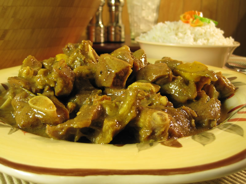 Curry Goat A traditional Jamaican dish in which goat meat is infused with the seasonings, flavours of curry powder, chopped onion, escallion, garlic, ginger, thyme and scotch bonnet. Serve With Rice, Steamed Veggie  $15.00