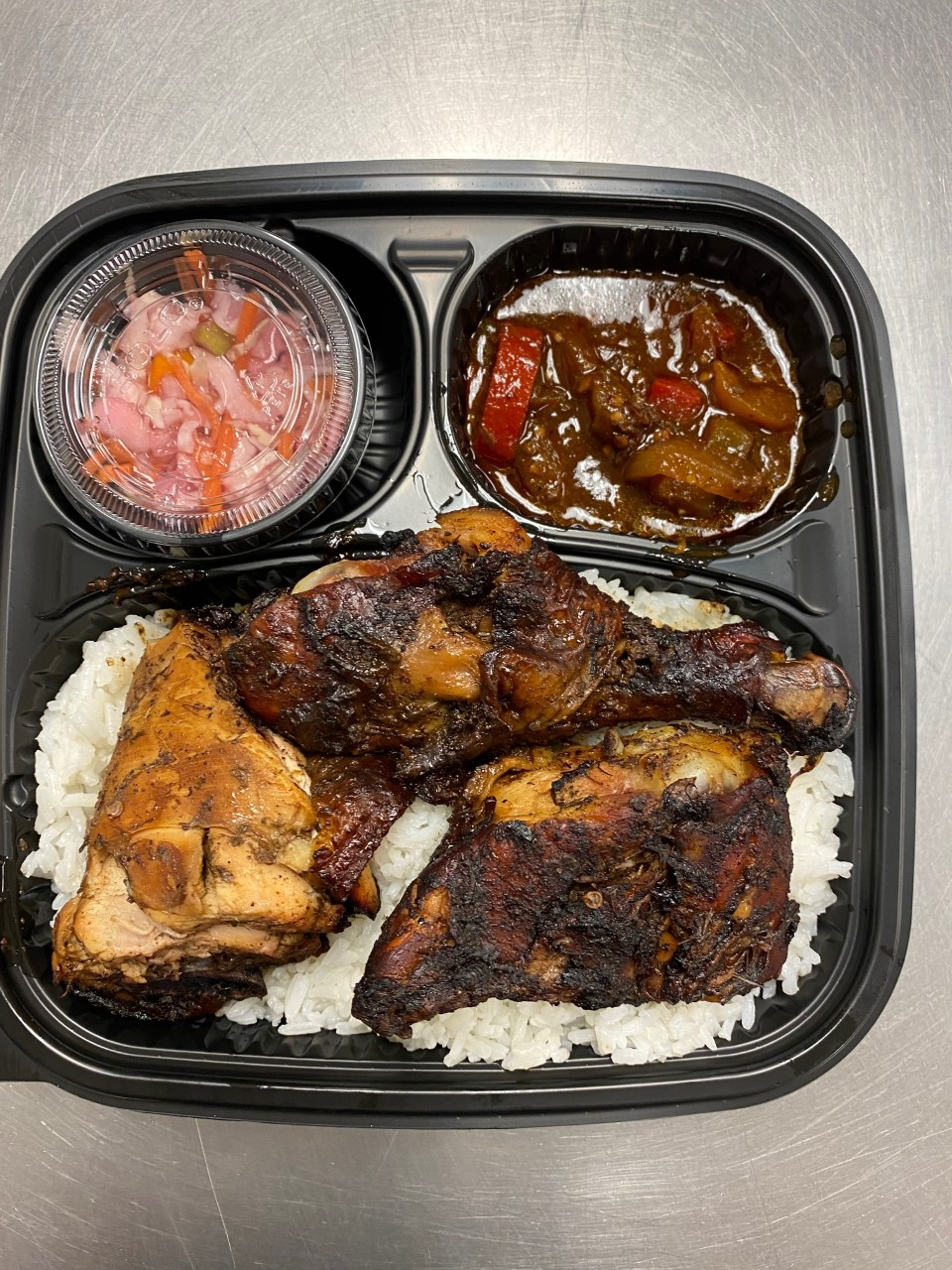 Jamaican Jerk Chicken A traditional Jamaican dish in which chicken is marinated with the jerk seasonings then grilled or cooked in the oven. Serve With Rice , cold Veggie Salad  $10.00